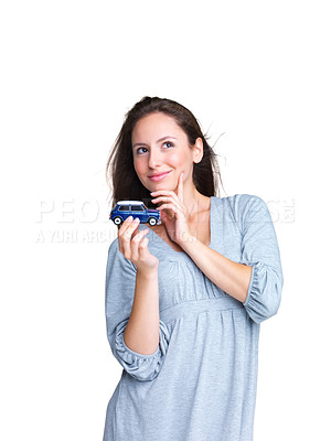 Buy stock photo Portrait of a beautiful young woman dreaming to purchase a new car against white background