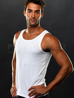 Buy stock photo Portrait of handsome man in vest standing with hands on hips against black background
