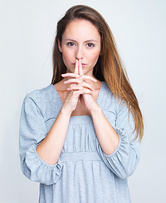 Buy stock photo Portrait of a pretty young female in thoughtful mood against grey background