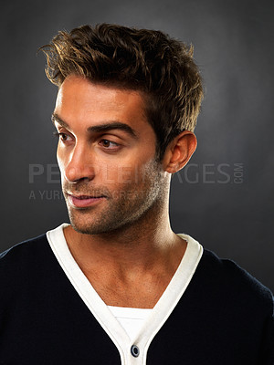 Buy stock photo Closeup of man smiling and looking away on black background