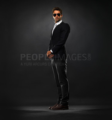 Buy stock photo Full length of handsome secret service agent standing on black background