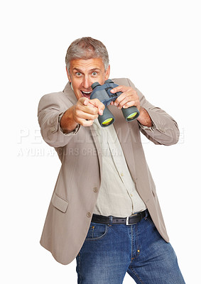 Buy stock photo Studio shot of a mature man pointing at you while holding binoculars against a white background