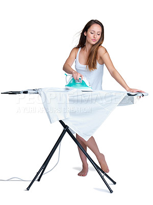 Buy stock photo Portrait of a pretty young female ironing clothes against bright background