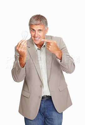 Buy stock photo Studio shot of a mature man showing you a lightbulb against a white background