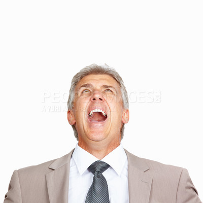 Buy stock photo Studio shot of a mature businessman screaming against a white background