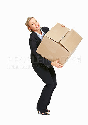 Buy stock photo Full length of business woman struggling with heavy carton over white background