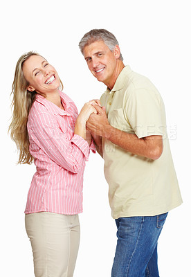 Buy stock photo Portrait of happy mature couple holding hands over white background