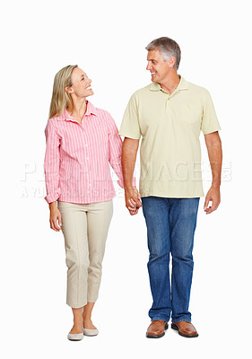 Buy stock photo Full length of happy mature couple in love holding hands on white background