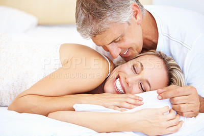 Buy stock photo Portrait of romantic mature couple lying in bed at home