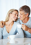 Mature couple having tea together