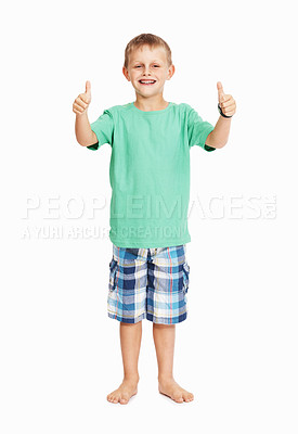 Buy stock photo Full length of young boy showing thumbs up with both hands over white background