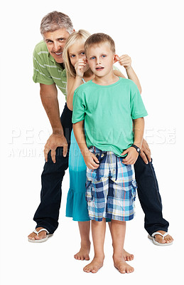 Buy stock photo Full length of cheerful father and children standing in line over white background