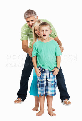 Buy stock photo Mature man and children standing in line over white background