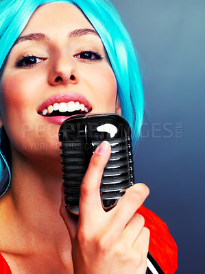 Buy stock photo Closeup portrait of a happy young female star performer singing with old fashioned microphone