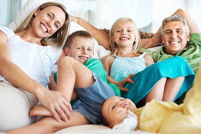 Buy stock photo Portrait of happy family relaxing together at home