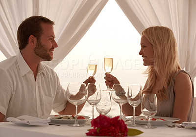 Buy stock photo Portrait of smiling young couple having dinner at the beach - Happy couple