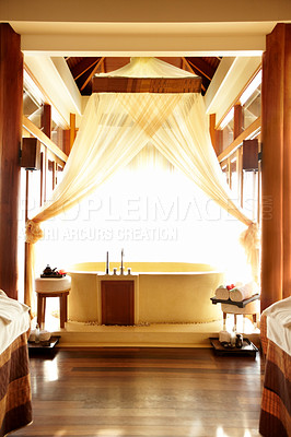 Buy stock photo Massage treatment room in a spa hotel with a bathtub designed with luxury