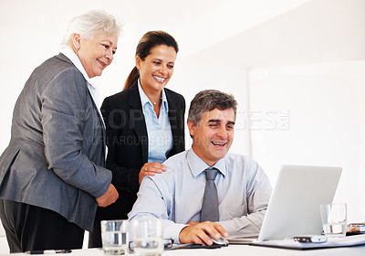 Buy stock photo Group of happy business people in meeting at office using laptop