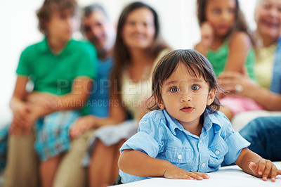 Buy stock photo Closeup portrait of an adorable boy with family sitting in the background