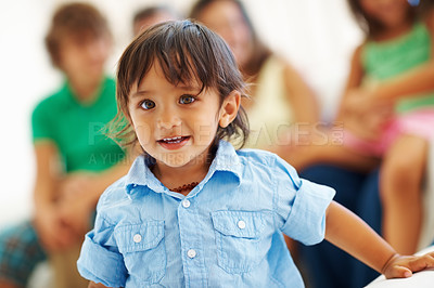 Buy stock photo Closeup portrait of a happy charming boy with family sitting in the background