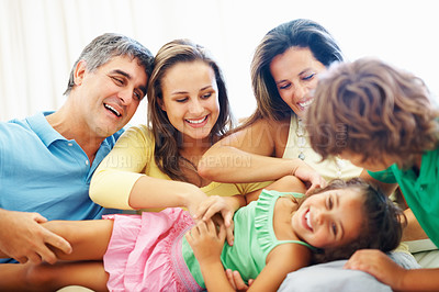 Buy stock photo Portrait of happy mature parents enjoying with their children
