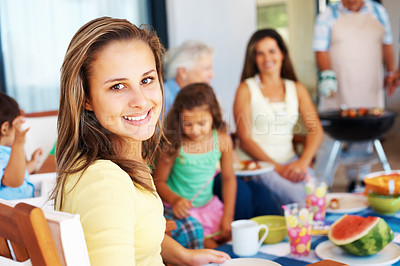 Buy stock photo Beautiful young girl having her meal with family