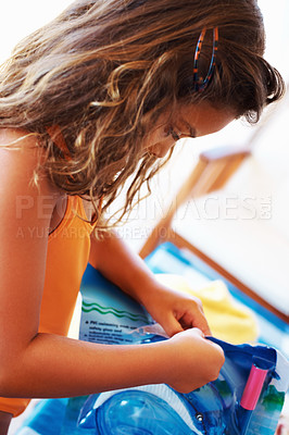 Buy stock photo Closeup of innocent little girl opening snorkel packet