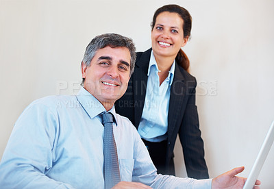 Buy stock photo Portrait of happy relaxed mature business couple with laptop smiling