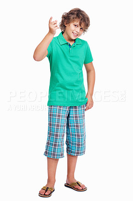 Buy stock photo Full length of a cute little boy pointing upward on white background