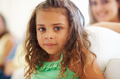 Buy stock photo Closeup of cute little girl with family sitting in the background