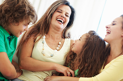 Buy stock photo Portrait of a mature mother enjoying with her kids