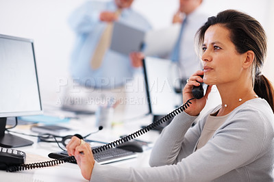 Buy stock photo Business woman over telephonic conversation with colleagues in background