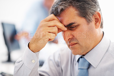 Buy stock photo Closeup of handsome business man with severe headache - copyspace