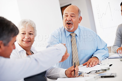 Buy stock photo Senior business man shaking hands with partner during meeting