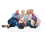 Smiling family sitting together on floor