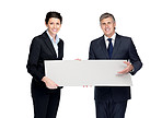 Confident businesspeople holdng a blank billboard against white