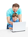 Happy father teaching his son to use the laptop