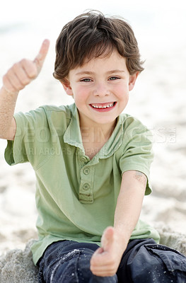 Excited little boy giving two thumbs up - Outdoor