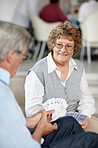 Enjoying retirement - Senior couple playing cards