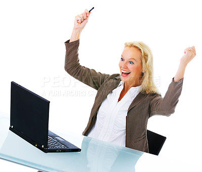 Buy stock photo Shot of an attractive businesswoman sitting in front of a laptop and celebrating isolated on white