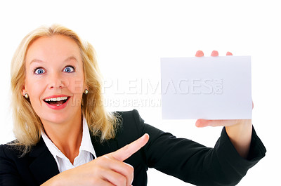 Buy stock photo Portrait of a mature businesswoman pointing at a blank  card isolated on white