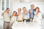 Smiling old couples showing thumbs up sign