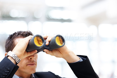Buy stock photo Portrait of a young business man with binoculars looking to the future
