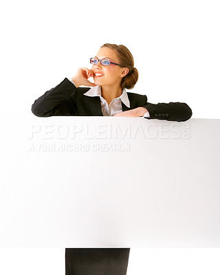 Buy stock photo Portrait of a beautiful businesswoman holding a blank billboard.
