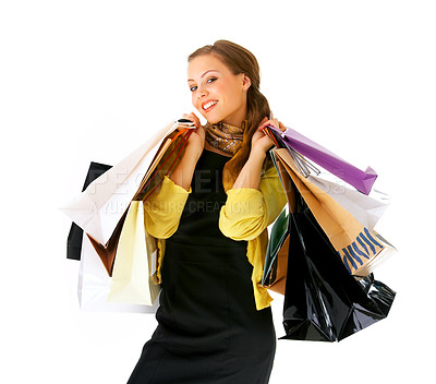 Buy stock photo Portrait of an attractive young woman holding several shoppingbags.