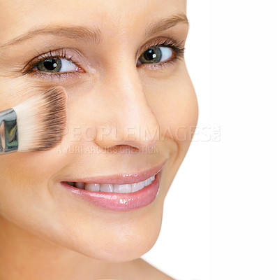 Buy stock photo Closeup portrait of a cute young female applying make up to face with a smile