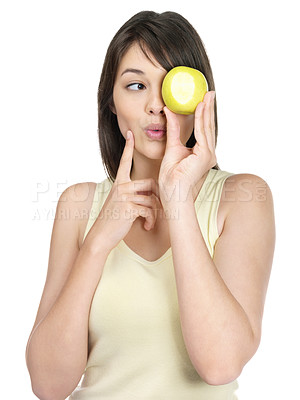 Buy stock photo Portrait of a pretty female holding a green apple against white