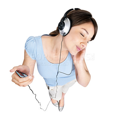 Buy stock photo Top view portrait of a cute young female enjoying music over headphones against white