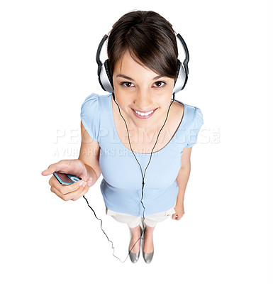 Buy stock photo Top view of a cute young caucasian female listening to music against white