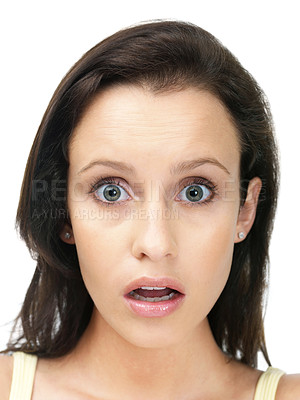 Buy stock photo Closeup portrait of a young lady looking surprised against white background